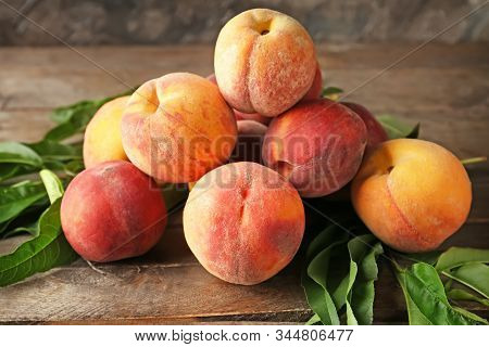 Mature Peaches On A Wooden Background. Peaches
