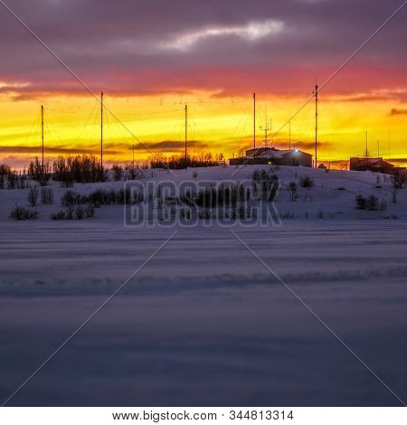 Landscape with the image of Murmansk weather station. Photo taken during the polar night
