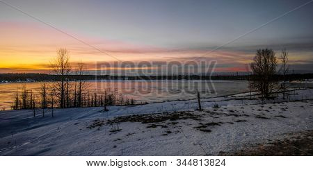 Landscape with the image of the ice covered frozen river Kem in Karelia, Russia