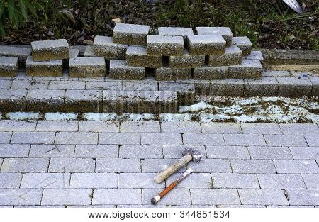 Maintenance Work On Paving With Interlocking Paving Stones. Building Materials Industry; Concrete Pr