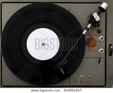 Turntable Vinyl Record Player On The Background White Wooden Boards. Sound Technology For Dj To Mix