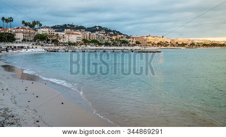 Croisette Beach And Cannes Cityscape At Dusk In Cannes France