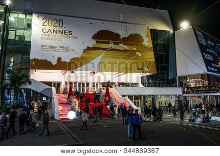 Cannes France, 28 December 2019 : Tourists On Cannes Film Festival Red Carpet Stairs And 2020 Board