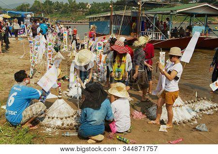 Luang Prabang, Laos - April 13, 2012: People Build Sand Pagodas At The Mekong River Bank During Lao