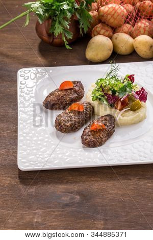 Beef Meat Balls Or Rissole With Mashed Potato On Wooden Table