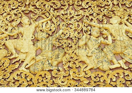 Luang Prabang, Laos - April 14, 2012: Elaborate Wood Carving At The Exterior Wall Of Xieng Thong Tem