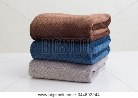 Stack Of Folded Soft Blankets Isolated On White Background