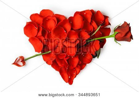 Rose petals in a shape of a heart with rose arrow isolated on white background