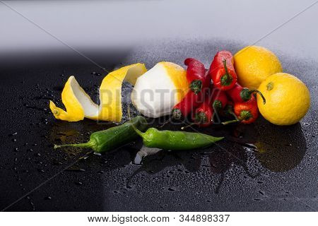Bunch Of Chili And Lemon Trio. Nuclear Union Of Tastes. Food Concept.