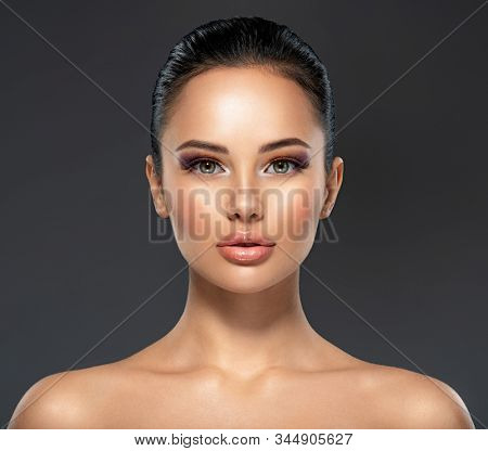 Front portrait of the woman with beauty face - isolated. Beauty face of the young beautiful girl with a healthy skin. Attractive female with a beautiful eyes. Skin care concept.