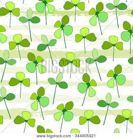 Seamless Pattern Of Green Leaves Of Clover On The Background Of Tiled Stripes. Vector Illustration O