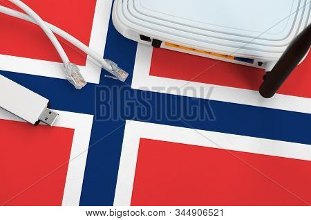 Norway Flag Depicted On Table With Internet Rj45 Cable, Wireless Usb Wifi Adapter And Router. Intern