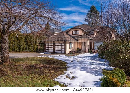Houses in suburb at Winter in the north America. Luxury houses covered nice snow.