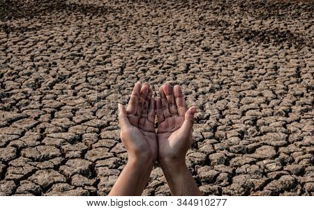 Lady Hand Waiting For Rainwater, Cracked And Dry Soil In Arid Areas Landscape, Drought Crisis Concep