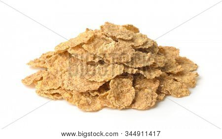 Pile of organic bran flakes isolated on white