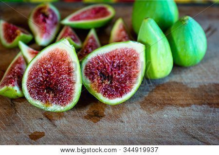 Fig - Fresh Figs And Sliced Fig Fruits Close-up Showing Texture On Cutting Board