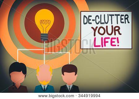 Conceptual hand writing showing De Clutter Your Life. Business photo showcasing remove unnecessary items from untidy or overcrowded places Three executive persons sharing idea Startup team meeting. poster