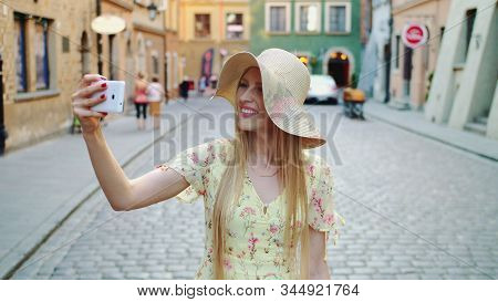 Woman Sightseeing And Taking Shots. Cheerful Woman Sightseeing And Taking Shots On Old Town Street.