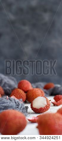 Fresh Litchi Fruits On A White Table Close Up