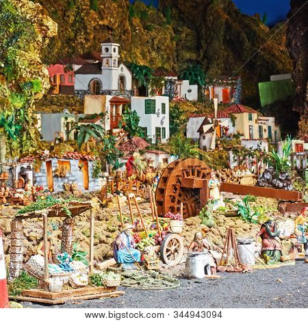Candelaria, Tenerife, Spain - December 12, 2019: Christmas Belen -  Statuettes of people and houses in miniature depicting life of old town (Market)
