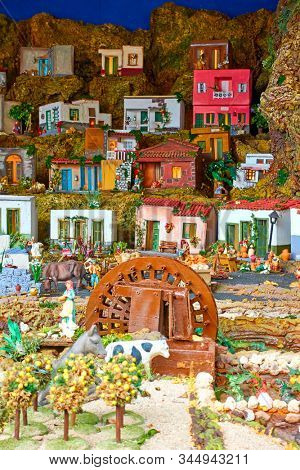 Candelaria, Tenerife, Spain - December 12, 2019: Christmas Belen -  Statuettes of people and houses in miniature depicting life of old Bethlehem