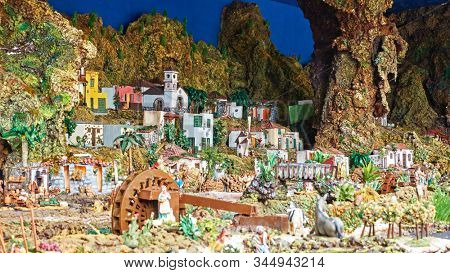 Candelaria, Tenerife, Spain - December 12, 2019: Christmas Belen -  Statuettes of people and houses in miniature depicting life of ancient Bethlehem
