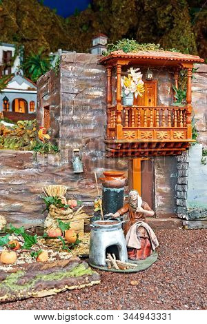 Candelaria, Tenerife, Spain - December 12, 2019: Detail of Christmas Belen -  Statuettes of people and houses in miniature depicting life of old town