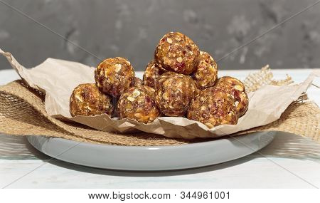 Homemade Energy Balls Like A Healthy Breakfast Or A Snack Of Raisins, Dried Apricots, Dates, Nuts An