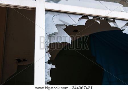 Acts Of Vandalism, Broken Windows In An Abandoned Building