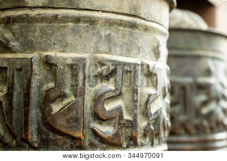 Spinning Buddhist Prayer Drums With Ancient Mantras Close Up. Fixture For Traditionhal Buddist Praye