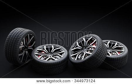 Set of wheels with modern alu rims on black background - banner composition. 3D illustration