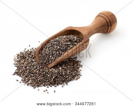 Organic chia seeds in wooden scoop isolated on white