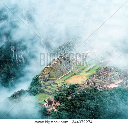 Aerial view of mountainious forested Machu Picchucovered with clouds