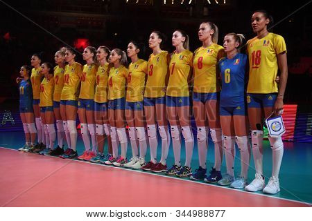 BUDAPEST, HUNGARY – August 23, 2019: Romanian National Team sing the national anthem, before the Netherlads (blue) – Romania (yellow) 2019 CEV Volleyball European Championship's women volleyball game.