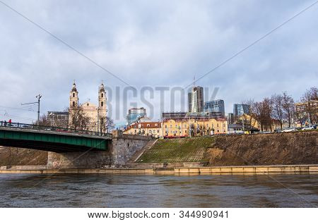 Vilnius, Lithuania - December 16, 2019: Bridge At Neris River And View Of The Old Town And The New C