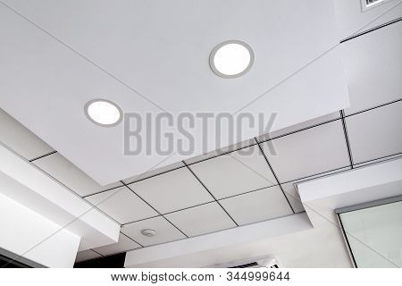 Multi-level Ceiling With Three-dimensional Protrusions And A Suspended Tiled Ceiling With A Built-in