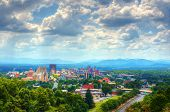 Asheville, North Carolina skyline nestled in the Blue Ridge Mountains. poster