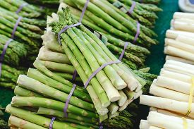 Bunches Of Fresh Raw Green Organic Asparagus Vegetables For Sale At Farmers Market. Vegan Food Conce