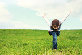 Young Boy Playing In A Field