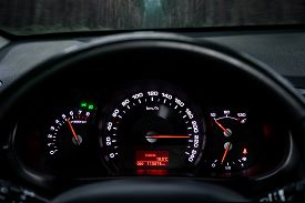 A Close-up Of A Car Control Panel With A Speedometer Indicating A Huge Speed Of 220 Km Per Hour, A T
