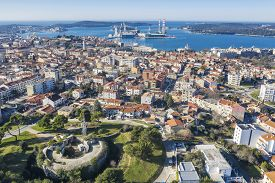 An Aerial View Of Pula With Amphitheatre And Port, In Foreground Monvidal Fortress, Pula, Istria, Cr