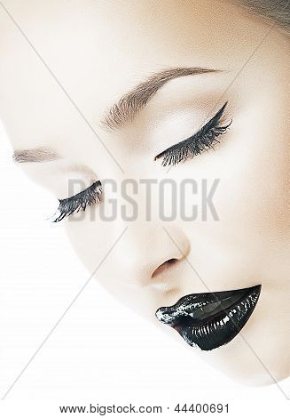 Dreaminess. Femininity. Dreamy Woman's Face With Closed Eyes. Shiny Black Lips