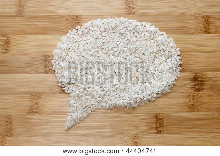 Rice On Bamboo Background