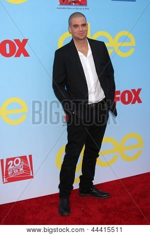 LOS ANGELES - SEP 12:  Mark Salling arrives at the Glee 4th Season Premiere Screening at Paramount Theater on September 12, 2012 in Los Angeles, CA