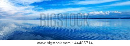 Sunset blue panoramic landscape. Orbetello lagoon with reflection Argentario Tuscany Italy. poster