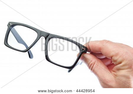 A Man Holds Glasses. On A White Background.