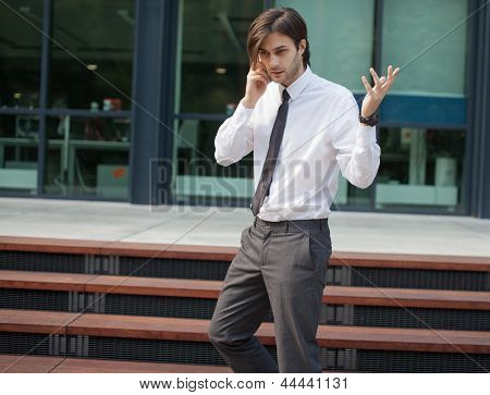 Handsome Business Man On A Phone Call