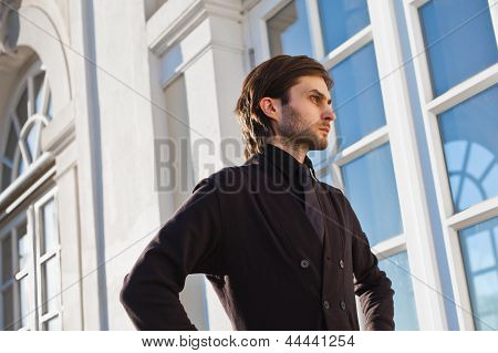 Man In Front Of House