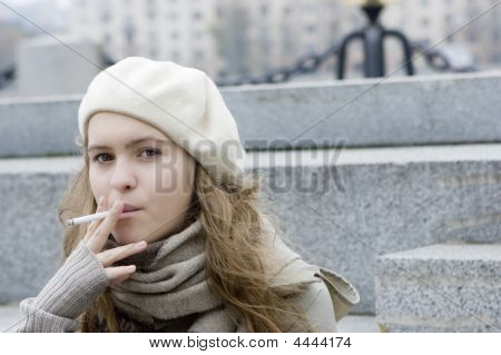 Young Teen Girl Sitting On The Jaggies And Smoking