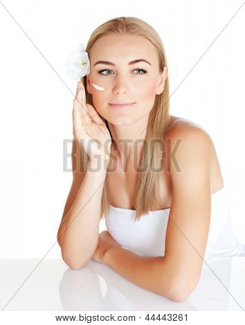 Portrait of young beautiful female apply day cream isolated on white background, enjoying dayspa, luxury spa salon, beauty concept